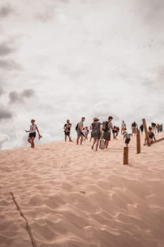 tourists in the dunes
