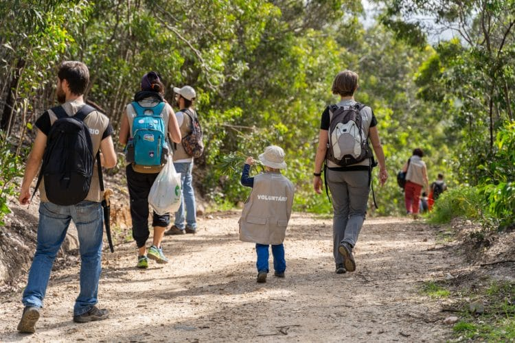 kid walking in a trail