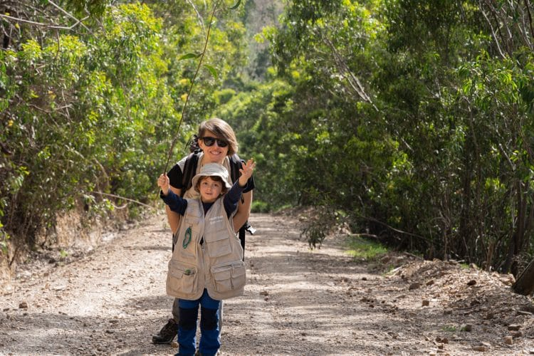 mon and son in a trail